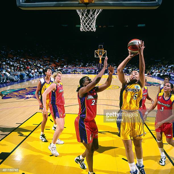 Allison Feaster of the Los Angeles Sparks grabs a shoots against the Phoenix Mercury at Staples Center on July 21 1999 in Los Angeles CA NOTE TO USER...