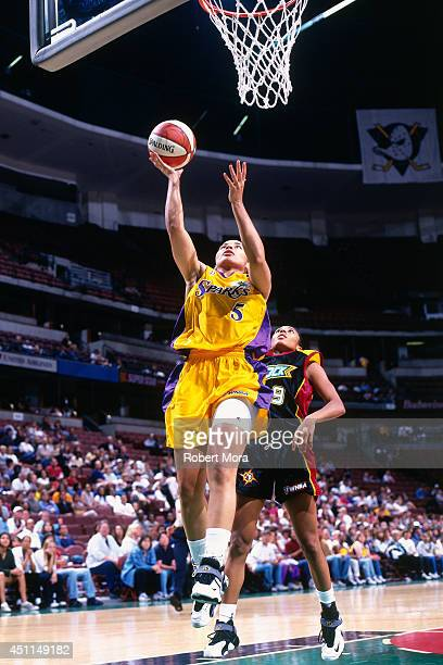 Allison Feaster of the Los Angeles Sparks shoots against the Detroit Shock at Staples Center on May 29 1999 in Los Angeles CA NOTE TO USER User...