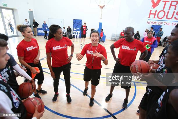 Allison Feaster Swin Cash Vanja Cernivec and Astou Ndiaye goes over a plan at the Basketball Without Boarders Africa program at the American...