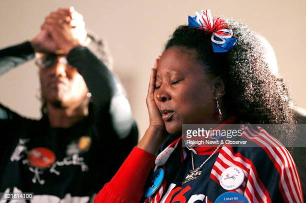 Allison Fenderson right and Lisa Wilder left watch as the returns come in during an election party hosted by the North Carolina Democratic Party at...