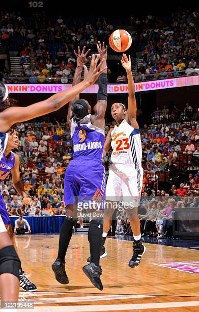 Allison Hightower of the Connecticut Sun passes the basketball against Marie FerdinandHarris of the Phoenix Mercury on August 26 2011 at the Mohegan...