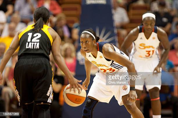 Allison Hightower of the Connecticut Sun waits on defense for Ivory Latta of the Tulsa Shock during a game at the Mohegan Sun Arena on August 21 2012...