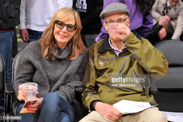 Allison Janney and her dad Jervis Spencer Janney Jr attend a basketball game between the Los Angeles Lakers and the Denver Nuggets at Staples Center...