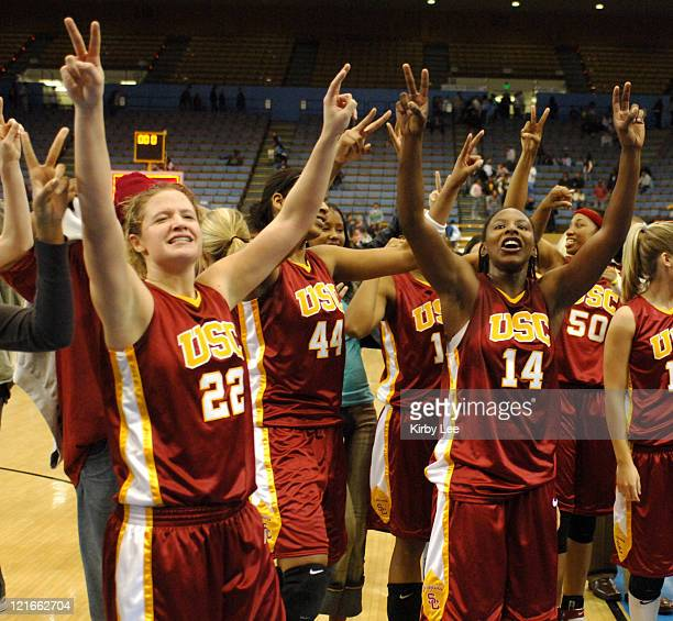 Allison Jaskowiak and Eshaya Murphy of USC celebrate 77-73 victory over UCLA in Pacific-10 Conference women's basketball game at Pauley Pavillion in...