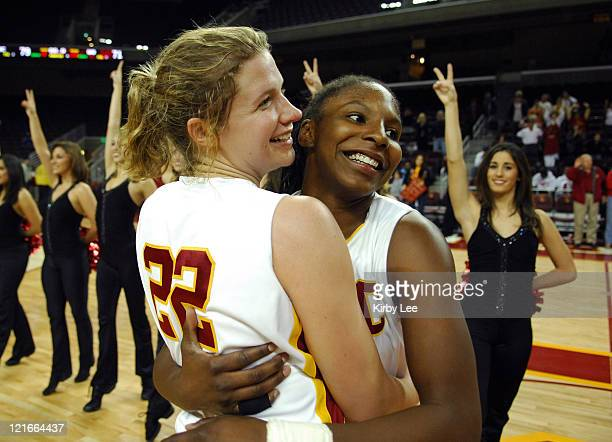 Allison Jaskowiak, left, and Eshaya Murphy of Southern California embrace in celebration after 79-71 double overtime victory over Oregon in...