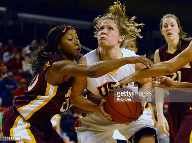 Allison Jaskowiak of USC tries to go up for a shot against Briann January of Arizona State during Pacific10 Conference women's basketball game at the...