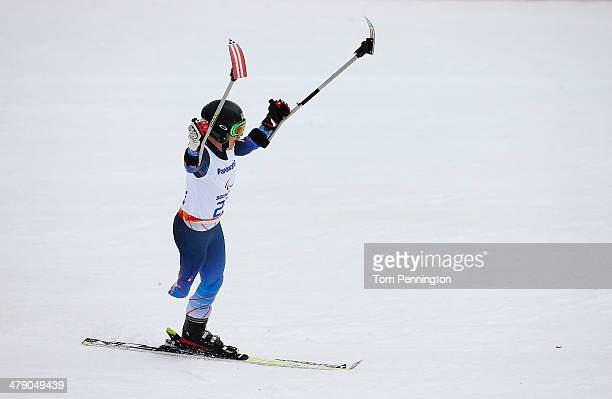 Allison Jones of the United States celebrates in the Women's Giant Slalom Standing during day nine of the Sochi 2014 Paralympic Winter Games at Rosa...