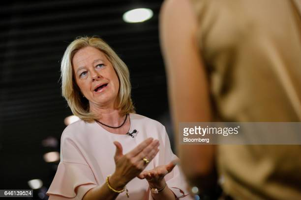 Allison Kirkby, chief executive officer of Tele2 AB, gestures while speaking during a Bloomberg Television interview on the second day of Mobile...