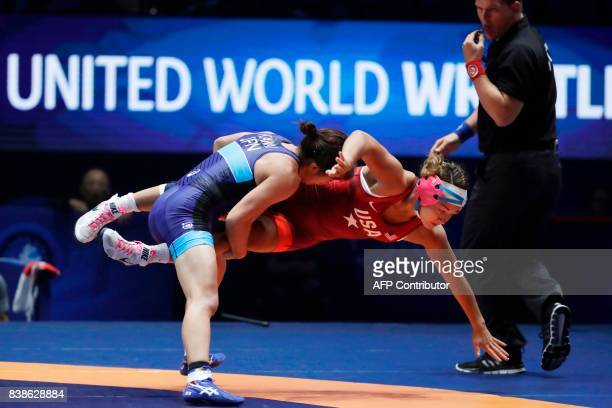 Allison Mackenzie Ragan of USA competes with Japan's Risako Kawai during the women's freestyle wrestling 60kg category final of the FILA World...
