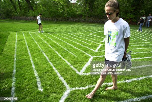 Allison Marshall of Austin Texas walks the Pentagon Labyrinth with her friend Gregory Tripp at the Boulder Creek Festival on Saturday Marshall and...