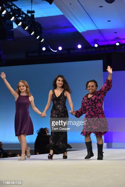 Allison McCollam Mikaela Hoover and Courtney Gaines on the runway at the Global Down Syndrome Foundation's Be Beautiful Be Yourself Fashion Show at...