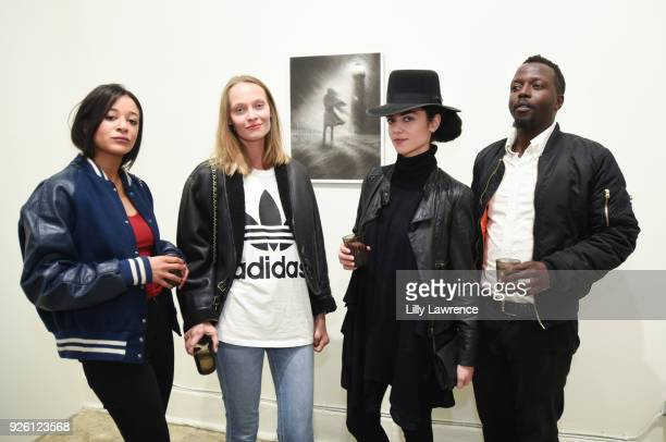 Allison Moore Vika Zuban Sophia Pashi and Kevin Moyo attend Charcoal Collection by Corran Brownlee opening reception on March 1 2018 in Los Angeles...