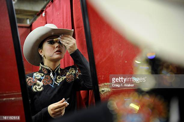 012010_NWSS_FEATURE_CFW Allison Nelson of Arvada CO prepares to show her horse Zippos Playgirl in the Youth Open Western Pleasure class at the...