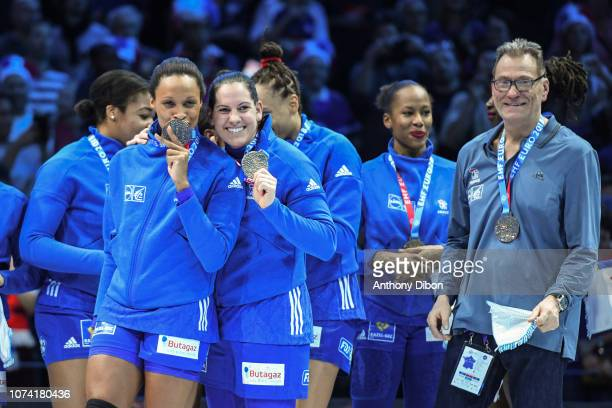 Allison Pineau Alexandra Lacrabere and Olivier Krumbholz coach of France celebrate the victory during the EHF Women's Euro 2018 Final match between...