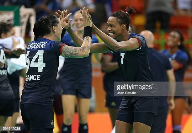 Allison Pineau and Alexandra Lacrabere of France celebrate winning the Women's semifinal handball match between France and The Netherlands on day 13...