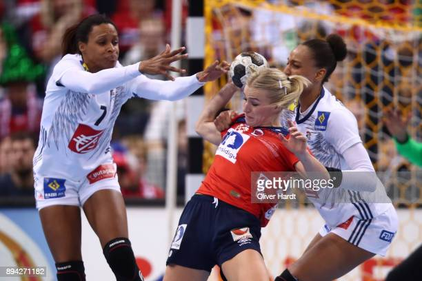 Allison Pineau and Beatrice Edwige of France and Stine Bredal Oftedal of Norway challenges for the ball during the IHF Women's Handball World...
