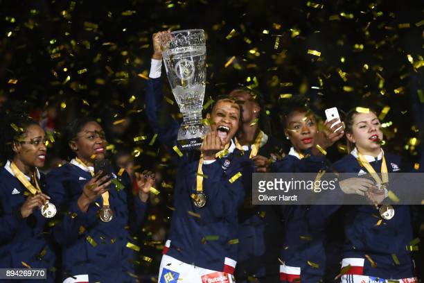 Allison Pineau and the team of France celebrate with the trophy after the IHF Women's Handball World Championship final match between France and...