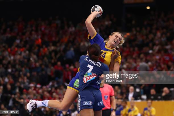 Allison Pineau of France and Johanna Westberg of Sweden challenges for the ball during the IHF Women's Handball World Championship Semi Final match...