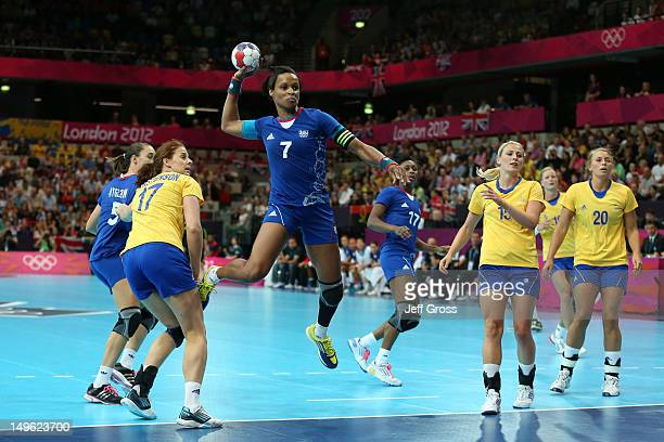 Allison Pineau of France attempts to score in their Women's Handball Preliminaries Group B match against Sweden on Day 5 of the London 2012 Olympic...