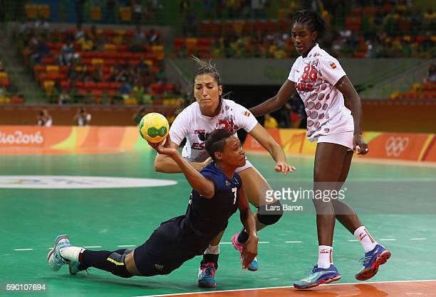 Allison Pineau of France is challenged by Lara Ortega Gonzalez of Spain during the Womens Quarterfinal match between Spain and France on Day 11 of...