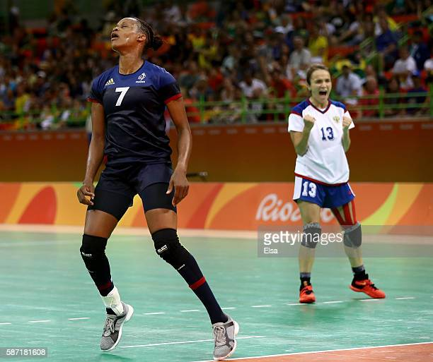 Allison Pineau of France reacts to a missed shot as Anna Vyakhireva of Russia celebrates on Day 3 of the Rio 2016 Olympic Games at the Future Arena...
