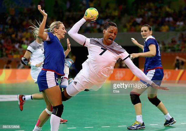Allison Pineau of France takes a shot during the Women's Handball Gold medal match between France and Russia at Future Arena on Day 15 of the Rio...