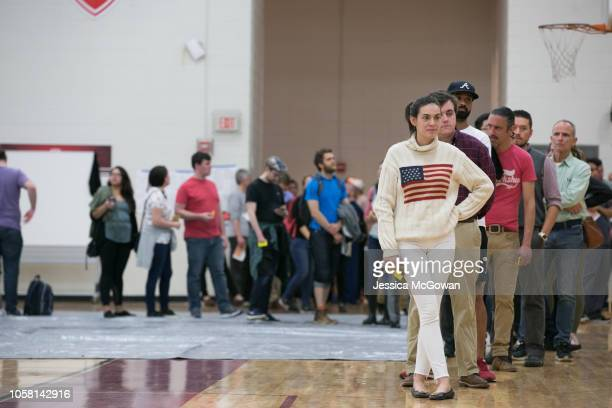 Allison Plummer waits in line with other voters to cast her ballot at Grady High School for the midterm election on November 6 2018 in Atlanta United...