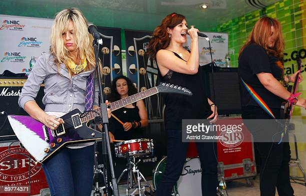 Allison Robertson Amy Cesari Brett Anderson and Maya Ford of The Donnas pay tribute to Les Paul at the NBC Experience Store as part of the Gibson...