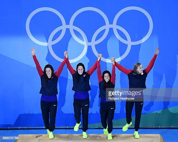 Allison Schmitt Leah Smith Maya Dirado and Katie Ledecky of the United States pose on the podium during the medal ceremony for the Women's 4 x 200m...