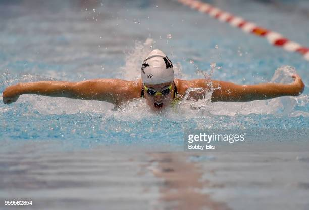 Allison Schmitt races in the Women's 100 meter butterfly preliminary race during the 2018 TYR Pro Swim Series at Indiana University Natatorium on May...