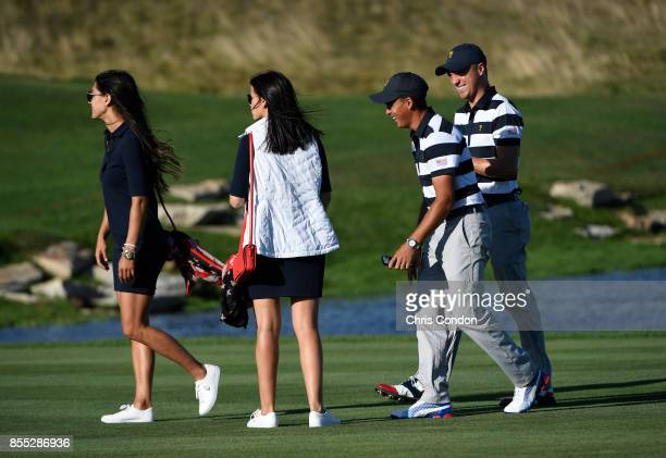 Allison Stokke and Jillian Wisniewski and Rickie Fowler of the US Team and Justin Thomas of the US Team during the first round of the Presidents Cup...
