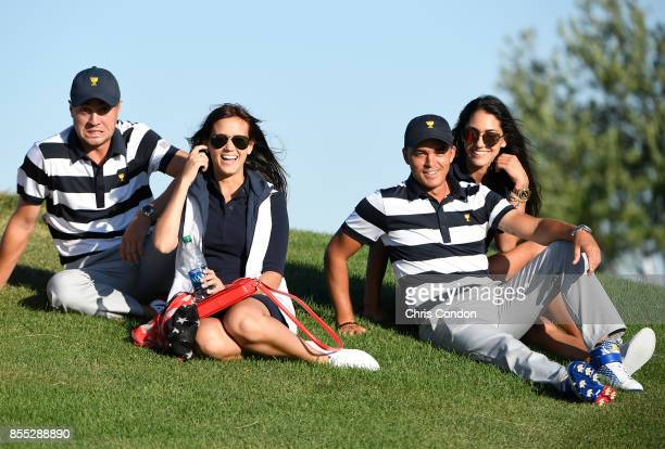 Allison Stokke and Rickie Fowler of the US Team along with Justin Thomas of the US Team and Jillian Wisniewski during the first round of the...