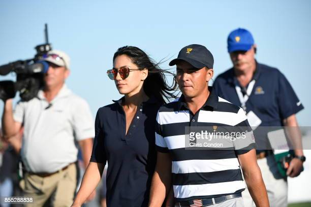 Allison Stokke and Rickie Fowler of the US Team during the first round of the Presidents Cup at Liberty National Golf Club on September 28 in Jersey...