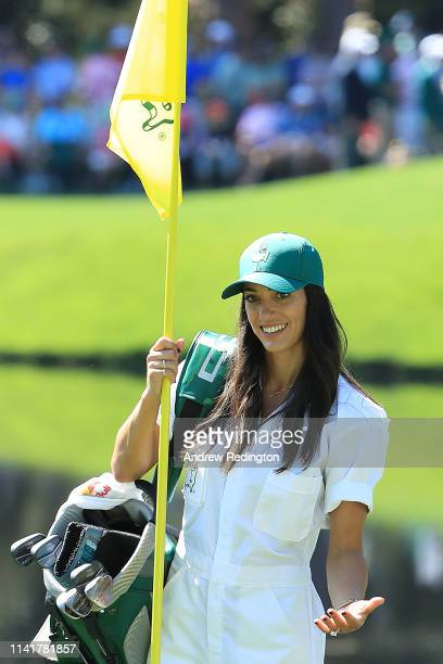 Allison Stokke fiance of Rickie Fowler reacts on a green during the Par 3 Contest prior to the Masters at Augusta National Golf Club on April 10 2019...