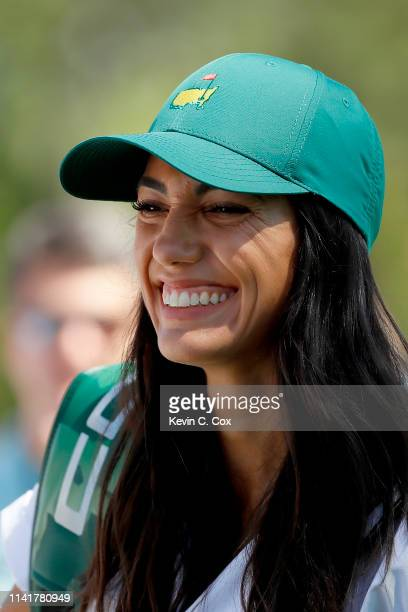 Allison Stokke, fiancee of Rickie Fowler of the United States , looks on during the Par 3 Contest prior to the Masters at Augusta National Golf Club...