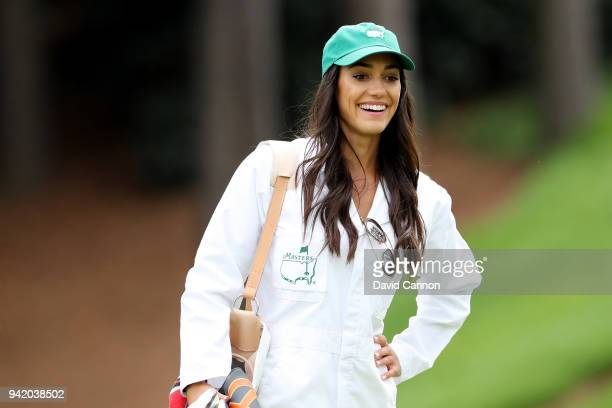 Allison Stokke girlfriend of Rickie Fowler of the United States looks on during the Par 3 Contest prior to the start of the 2018 Masters Tournament...