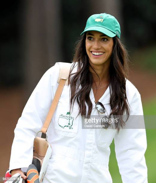 Allison Stokke girlfriend of Rickie Fowler of the United States smiles during the Par 3 Contest prior to the start of the 2018 Masters Tournament at...