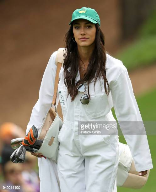 Allison Stokke girlfriend of Rickie Fowler of the United States walks the course during the Par 3 Contest prior to the start of the 2018 Masters...