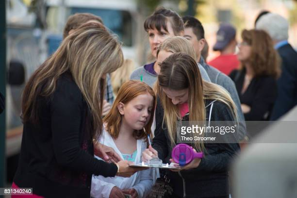 Allison Turner and Danielle Gordon sign in as spectators before the civil case for Taylor Swift vs David Mueller at the Alfred A Arraj Courthouse on...