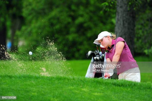 Allison Tyler of Indianapolis hits out of the bunker during the Division II Women's Golf Championship held at the Findlay Country Club in Findlay OH...