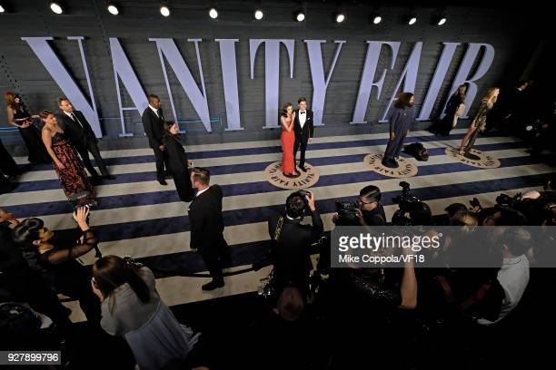 Allison Williams and Ricky Van Veen pose for pictures at the 2018 Vanity Fair Oscar Party hosted by Radhika Jones at Wallis Annenberg Center for the...