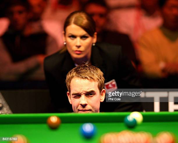 Allister Carter of England looks down the table whatched by referee Michaela Tabb during his match with Ronnie O'Sullivan of England during the...