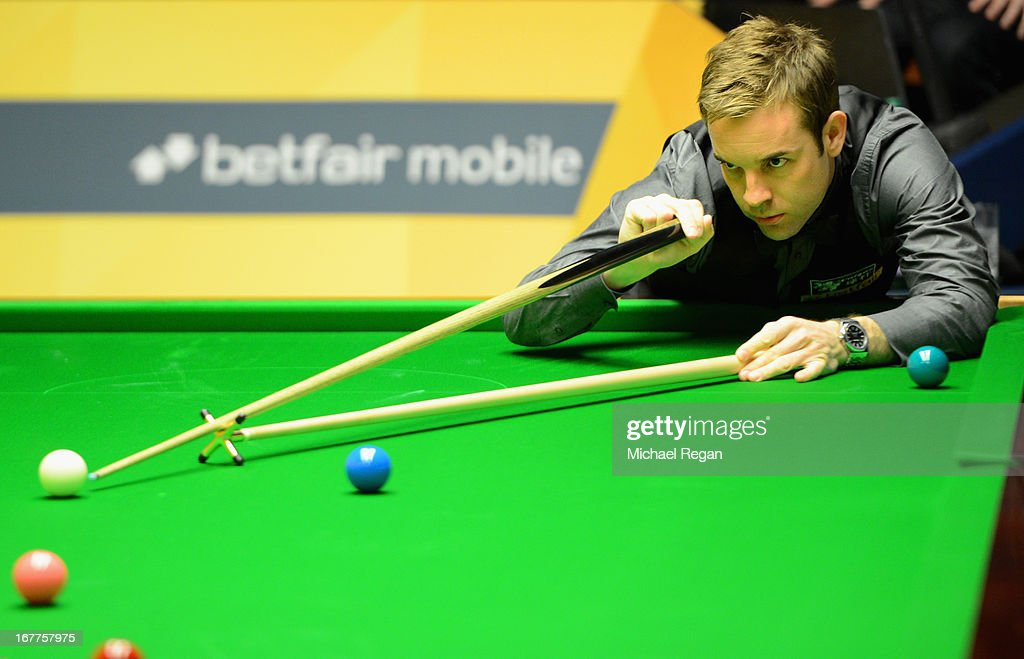 Allister Carter of England plays a shot in his match against Ronnie O'Sullivan of England during the Betfair World Snooker Championship at the Crucible Theatre on April 29, 2013 in Sheffield, England.