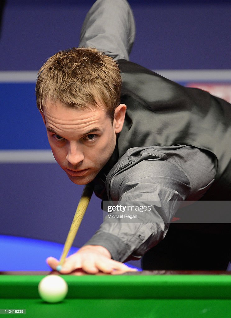 Allister Carter of England plays a shot in his round one match against Mark Davis of England during the Betfred.com World Snooker Championship at the Crucible Theatre on April 26, 2012 in Sheffield, England.