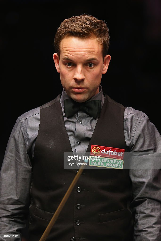 Allister Carter of Great Britain looks on during his quarter-final match against Neil Robertson of Australia on Day Five of the 2015 Dafabet Masters at Alexandra Palace on January 15, 2015 in London, England.