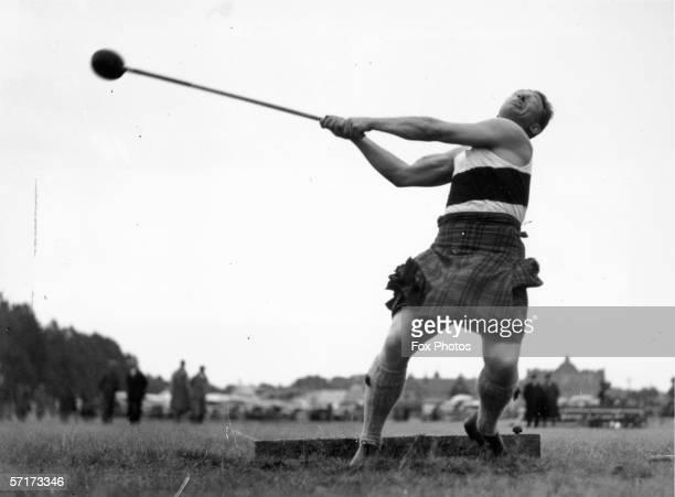 Allister Stuart throws the heavy hammer at the 64th Aboyne Highland Games, 5th September 1935.