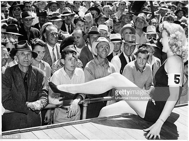 AllMale Crowd Watching Contestant in onepiece Bathing Suit Perform during Beauty Contest Los Angeles California USA 1943