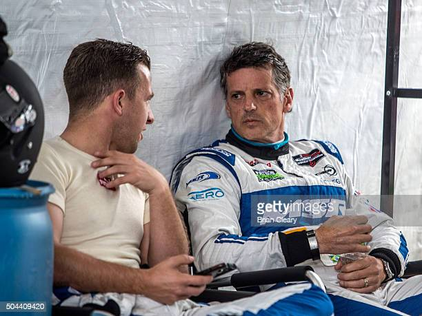 J Allmendinger and Oswaldo Negri Jr talk as they sit together in the pits during the Roar Before the 24 IMSA WeatherTech Series testing at Daytona...