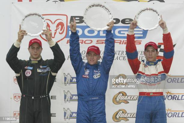 AJ Allmendinger celebrates with Rafael Sperifico and Dan Di Leo on the podium at the Barber Dodge Pro Series race at the Molson Indy Vancouver round...