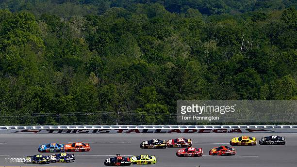 J Allmendinger driver of the Best Buy Fordleads the field through turn two during the NASCAR Sprint Cup Series Aaron's 499 at Talladega Superspeedway...